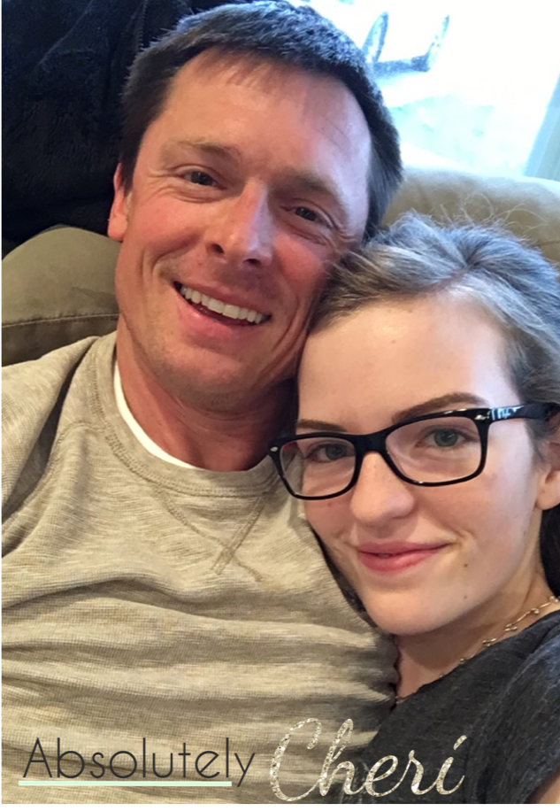 Wife snuggling with husband selfie